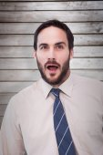 Shocked businessman with mouth open a — Stock Photo