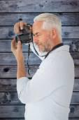 Man taking a photo on digital camera — Stock Photo