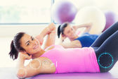 Two fit young women doing pilate exercises — Stock Photo