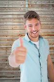 Man showing thumbs up to camera — Foto de Stock