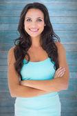 Pretty brunette smiling at camera — Stock Photo
