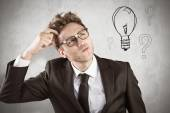 Geeky businessman scratching his head — Stock Photo