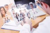 Doctors using laptop and digital tablet — Stock Photo