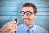 Geeky businessman holding a cable — Zdjęcie stockowe