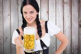 Oktoberfest girl holding beer tankard — Stock Photo
