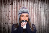 Woman in warm clothing drinking coffee — Stock Photo
