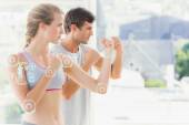 Serious couple standing in boxing stance — Stock Photo