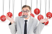 Geeky shrugging işadamı ısırma hesaplayıcı — Stok fotoğraf
