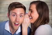 Woman whispering secret into friends ear — Stock Photo