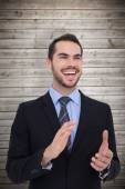 Businessman standing and clapping — Stock Photo