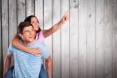 Man giving girlfriend a piggyback ride — Stock Photo