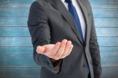 Businessman holding out his hand — Stock Photo