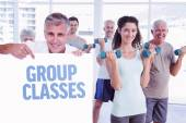 Man showing a poster against group classes — Stock Photo