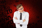 Businessman thinking with arms crossed — Stok fotoğraf