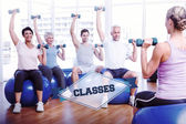 The word classes and fitness class with dumbbells — Stock Photo