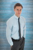 Serious businessman with hands in pockets — Stock Photo