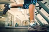 Woman walking on the treadmill — Stock Photo