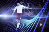 Football player in white kicking — Stock Photo