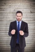 Angry businessman with closed fists — Stock Photo