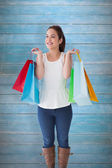 Brunette posing with shopping bags — Stock Photo
