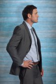 Serious businessman with hand on hip — Stock Photo