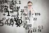 Smiling businessman showing calculator — Stockfoto