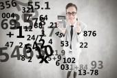 Smiling businessman showing calculator — Zdjęcie stockowe