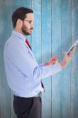 Businessman scrolling on his tablet — Stock Photo