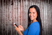 Young brunette sending a text — Stock Photo