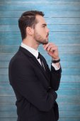 Thoughtful businessman touching his chin — Stock Photo