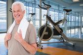 Fit senior man against spin bikes — Stock Photo