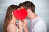 Romantic couple holding heart — Stock Photo