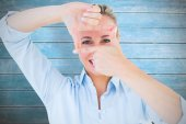 Smiling blonde making a hand gesture — Stock Photo