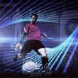 Composite image of goalkeeper kicking ball — Stock Photo #69040059