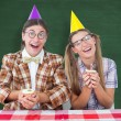 Composite image of geeky hipsters celebrating birthday — Stock Photo #69047145