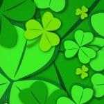 Green shamrocks on green background — Stock Photo #69047753