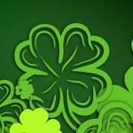 Green shamrocks on green background — Stock Photo #69049619