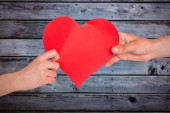Hands holding red heart — Stock Photo