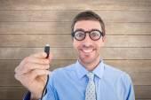 Geeky businessman holding cable — Zdjęcie stockowe