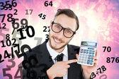 Naukowy biznesmen wskazując kalkulator — Zdjęcie stockowe