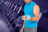 Fit man exercising with dumbbells — Stock Photo