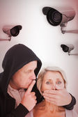 Older man silencing his fearful partner — Stock Photo