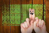 Composite image of patricks day fingers — Stock Photo