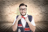 Geeky hipster wearing christmas vest — Stock Photo