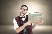 Geeky hipster holding a retro radio — Stock Photo
