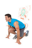 Sporty smiling man in running stance — Stock Photo