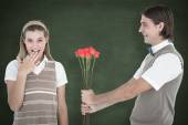 Geeky hipster offering red roses — Stock Photo