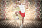 Geeky hipster posing in sportswear with dumbbells — Stock Photo