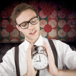 Geeky businessman holding alarm clock — Stock Photo #69050147