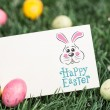 Composite image of easter bunny with greeting — Stock Photo #69050517